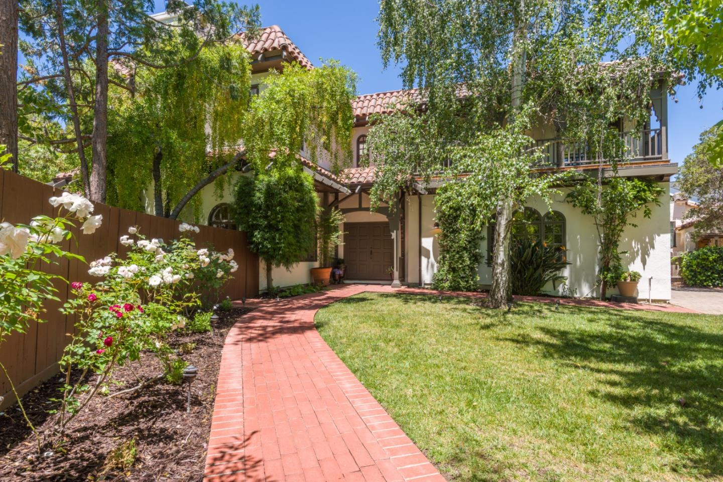 FIRST OPEN HOUSE Saturday and Sunday 1-4.  Stately and stunning Mediterranean home located near downtown Burlingame Ave, parks, transportation.  Gated large lot with lovely gardens, patios, fountain, and al fresco dining areas.  Grand 2 story entrance with skylights for natural light.  3800 sq feet of well thought out living spaces, updated by current owner with high quality stainless steel appliances, a master bath sauna, 2 fireplaces in master suite and living room. Along with 3 upstairs large bedrooms all with their own baths, there is a 4th bedroom suite located on the main floor with its own entrance and a lovely view to the courtyard and fountain. In addition, there are double pantry closets in the kitchen, a 3 car garage with lots of parking, a charming traditional balcony off the master suite overlooking the birch trees in the front garden.