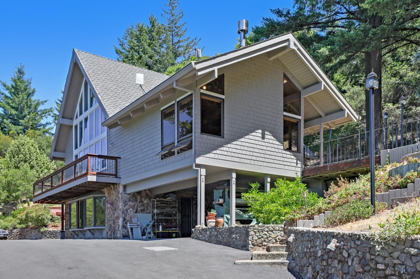 Highly sought after, private property on 2.78 acres. 3 BR/2.5 BA game/hobby/rental room with private entry, just 9 miles from downtown Saratoga, 14 miles from downtown Los Gatos. Main floor bedrooms and both bathrooms feature heated floors. Hardwood floors throughout. Enjoy nearby city life with exceptional restaurants, live music, and shops, then retreat to your serene and tranquil haven for a soak in the spa under starry skies. Close access to world class hiking, mountain biking, fresh air, and incredible views! Open floor plan includes floor to ceiling windows, a huge deck perfect for entertaining, or just enjoying a private family dinner watching the sunset. Zoning allows horses and chickens. Opportunity to grow vegetables/raise chickens. Award winning Los Gatos, and Saratoga schools. 2 car garage with workshop and 220V to handle the most power hungry tools you may have. Workshop has its own views. Located near beautiful Castle Rock State Park. Lots of upgrades, and move in ready!