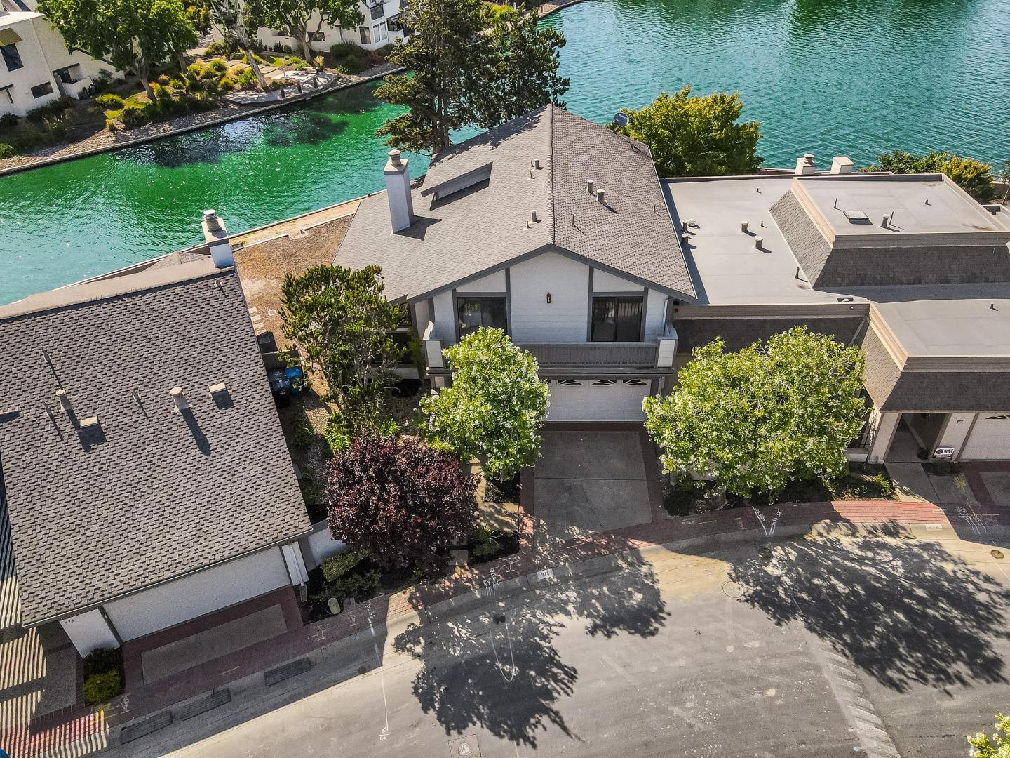 Welcome home to this incredible 4bd/2.5ba waterfront gem located in the heart of beautiful Foster City in the quiet and well-maintained Bayporte Community. With 2760 sq ft of living space, this bright and spacious home boasts vaulted ceilings in the living room and primary suite, formal dining, and gorgeous views of the water.  Water views can be seen from the living room, dining room, kitchen, family room, 1st bedroom and the primary suite which has a its own private deck that overlooks the backyard and water.  The 2nd and 3rd bedrooms share a balcony off the front of the home.  Fresh paint and new carpets make this home move-in ready.  Enjoy great Foster City schools, bike/jogging trails, water sports on the lagoons, and community parks.  Centrally located between SF and Silicon Valley, near Hwy 92 and 101 w/ connections for all commute directions. Bayporte Community Association has access to two community pools, a community play area & beautifully landscaped common areas.