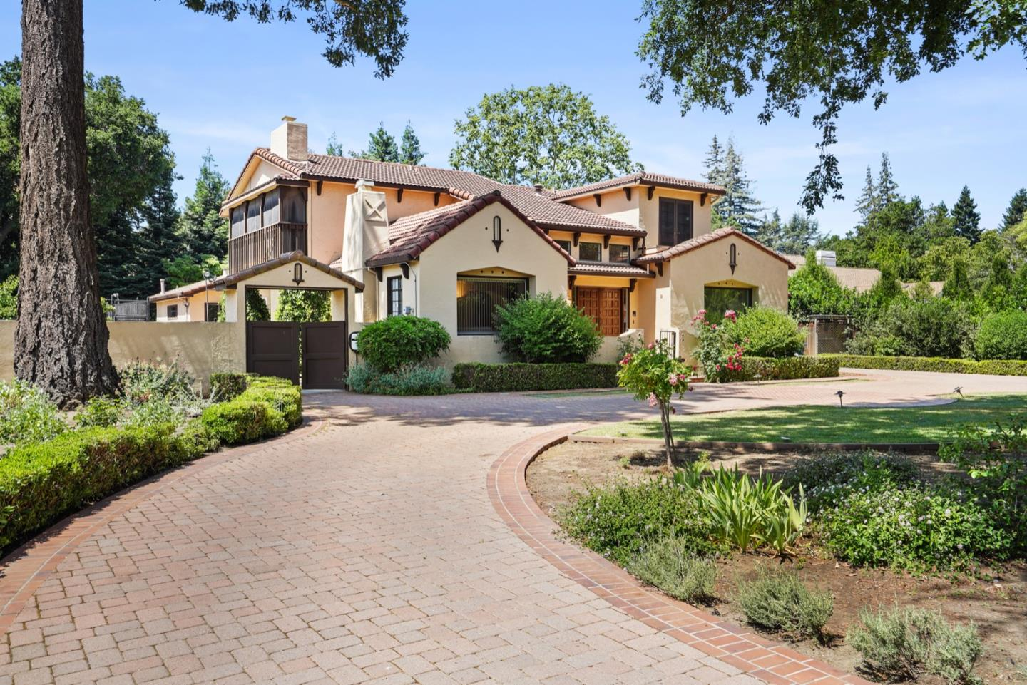 We are pleased to present this peaceful oasis on just under an acre of beautifully landscaped level land in the heart of coveted Central Atherton. On a quiet, tree-lined lane with double gated semicircular stone driveway, this imposing & updated 1928 Mediterranean family home emanates the feeling of resort living inside and out with every detail. Enjoy summer fun with a sparkling pool & games on the sport court. Main House is 3,805 sqft with 5 bedrooms & 4 full baths PLUS a 1,200 sqft detached 1 bed, 1 bath, self-contained ADU. Total 5,000 sq ft (+/-) of living space. Media and exercise rooms. Four car garage. Tesla/EV ready.  Solar fully owned. All wiring including data fiber underground. Lawned yard and gardens with mature fruit trees & foliage. Close to Silicon Valley and top schools, including Stanford University, Amador is in the perfect location for education, business, shopping and dining. We look forward to showing you the Best Value in Central Atherton. www.50amadoravenue.com
