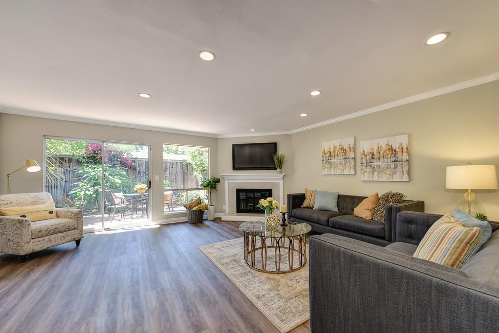 Centrally located (University Avenue) 2 bedroom, 2.5 bath, in gated community on the West side of Hwy 101. Open floor plan, natural sunlight, recessed lighting, fireplace, and private serene patio. Generously sized bedrooms each with their own balconies. Refreshed kitchen with stainless appliances, Bosch dishwasher, professional range hood with stainless backsplash, new gas range, and new F&P counter depth refrigerator. In-unit laundry with brand new washer dryer, private garage with automatic opener. Community pool and spa, low HOA's. Fantastic location near downtown Palo Alto and Stanford.