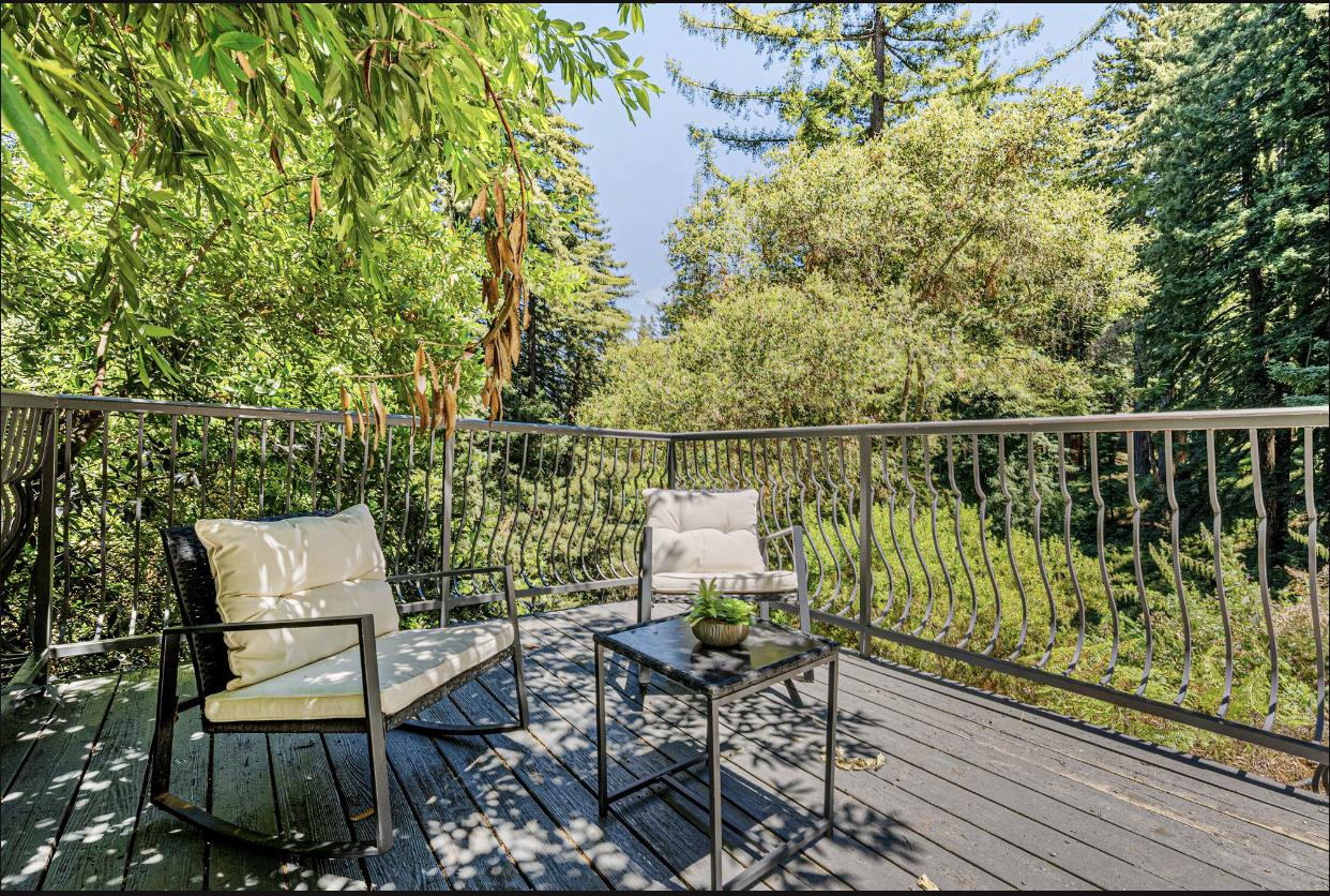 Let your mind unwind under the majestic Redwood trees. Surrounded by the natural beauty of the area, this property offers exceptional privacy in a tranquil setting, it doesn't get better than this! As you enter the home you are greeted by a formal Living room to your right you will enter an open floorplan dining/family room and a beautiful kitchen with a suite of high end appliances.  The 3 bedroom, 2 bath home is designed to take full advantage of the surrounding landscape. Enjoy your own private Gym and wine cellar. The Lower level is an apartment with a separate entrance, Dining Room, living room, two bed rooms and 1 full bathroom with abundant natural light and treetop views. Property is surrounded by a Large deck for entertainment and outdoor barbecue area. This quiet location combines a restful retreat with convenience to local shopping, restaurants, hiking and horse trails as well as commute routes, Stanford University and Portola Valley Schools.