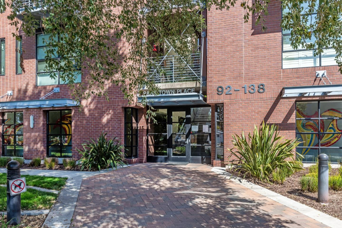ParkTown Place offers a lifestyle that mingles urban living with a small town appeal in the heart of downtown Campbell.  This single level, end unit condo has many upgrades and exemplifies pride of ownership. Enjoy all the vibrancy of shops, restaurants, parks and entertaining, and come back home to a private, safe and peaceful setting. No neighbors across or above the unit.  Bright open living space with custom built-in cherry wood cabinetry with matching crown molding, built in lights and roll out trays. Gourmet kitchen featuring granite countertops & stainless steel appliances. Plantation shutters, new paint, upgraded carpet, crown molding and upgraded baseboards throughout. This premier complex offers privacy with secured gated underground parking with 2 dedicated parking spaces and oversized elevator. Great location, close to farmers market, Los Gatos Creek Trail, Campbell Park, Pruneyard shopping center, Trader Joe's, Whole Foods, Light Rail station & convenient access to Hwy 17.