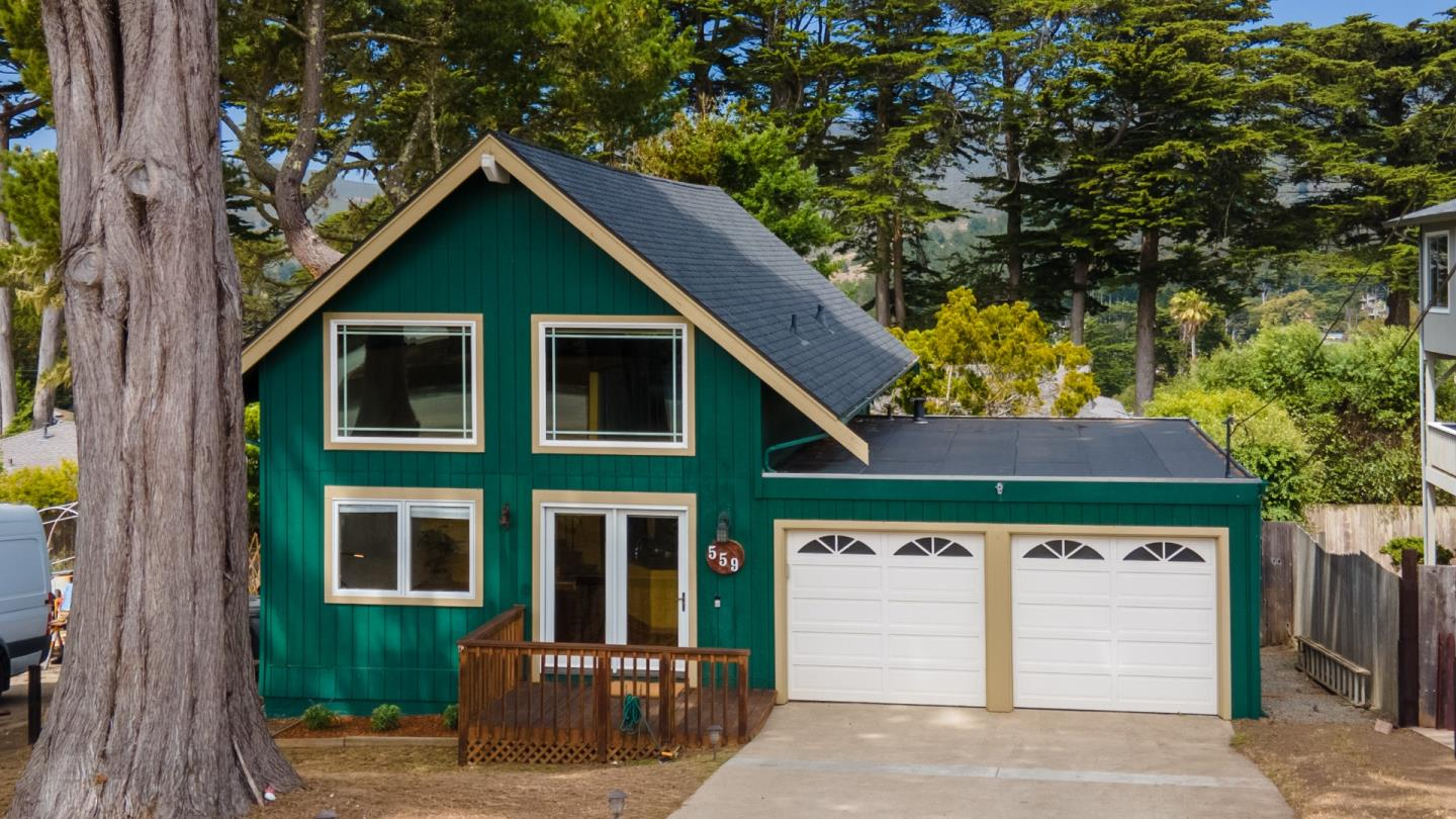 Updated cabin-style home in sunny back of Montara with both ocean and mountain views from the large entertaining-sized back deck. Located on a quiet street around the corner from miles of hiking trails, 2-story vaulted wood beam ceiling brings character and a great classic and open feel. The kitchen is efficient and high-quality with special design elements such as stainless walls and backsplash, a pot filler, 6-burner chefs range, and a gorgeous slate floor. The updated bathroom is outfitted with Restoration Hardware fixtures and a deep soaker tub, along with built-in storage. There are hardwood floors on the main level and stairs. The freshly carpeted loft, with 2 large view windows, can be a bedroom, office, or hobby room. The two-car attached garage provides easy access from the front to back yards, and into the home and kitchen. This is a great location for living a serene lifestyle near open space, community, and a local coffee shop.