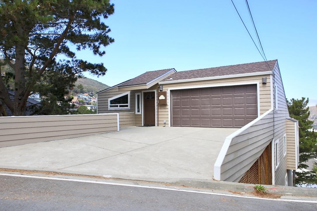 Fantastic, contemporary gem situated on a gentle hill in Brisbane! You will enjoy the vaulted ceilings, and hardwood floors throughout. Built in 1988, this home has 4 bedrooms and 2.5 baths, family room, office and deck with a hot tub! Views of San Bruno Mountain and downtown SF make this place truly special. Brisbane is a small and charming town of around 4,000 residents that is nestled in a quiet hillside of San Bruno Mountain.  It lies adjacent to the San Francisco Bay and is only minutes away from both the borders of San Francisco and South San Francisco. The sense of community in Brisbane is notably one of its greatest assets. Life in a small and tight knit town allows citizens to enjoy a quality and pace of life incomparable to those in most big cities. Brisbane enjoys Concerts in the Park, community volunteer gatherings, and much more. The prime location of Brisbane truly offers the best of both worlds. Free shuttle to BART and CALTrain. Public pool!