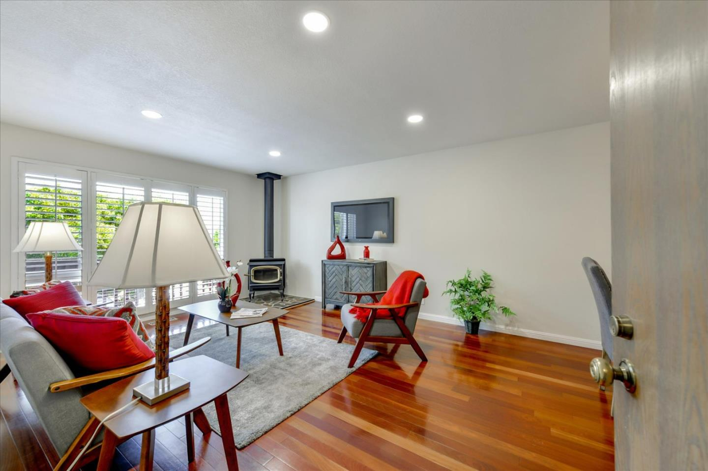 This gorgeous 2 bedrooms,1.5 bath townhouse style condo located in desirable SSF. Remodeled with meticulous attention to every detail.The main level boasts an open living/dining rm combo,custom plantation shutters,hdwd flrs, wd burning fp (only one in complex),recessed lights,freshly painted interior & counter that opens to kitchen.The kitchen boasts hdwd flrs,custom wood cabinets,quartz counters w/moroccan tile backsplash,microwave oven, stainless refrigerator,oversize sink & custom window covering.The spacious patio is ideal for family cookouts. Upstairs features a large main bedrm with city views,custom wood closet doors & newer carpet. The additional bedrm has ample closet space w/custom doors & view of green foliege.Also included are dble pane windows,w/w carpeting upstairs,new light fixtures,attached 1 car garage w/washer/dryer inside. Close to Genentech, Biotech Firms, Bart, Kaiser Hospital, SFO, San Francisco, Silicon Valley, Hwys 101 & 280. Open House Sun 8/1 1:30-4:00 p.m.