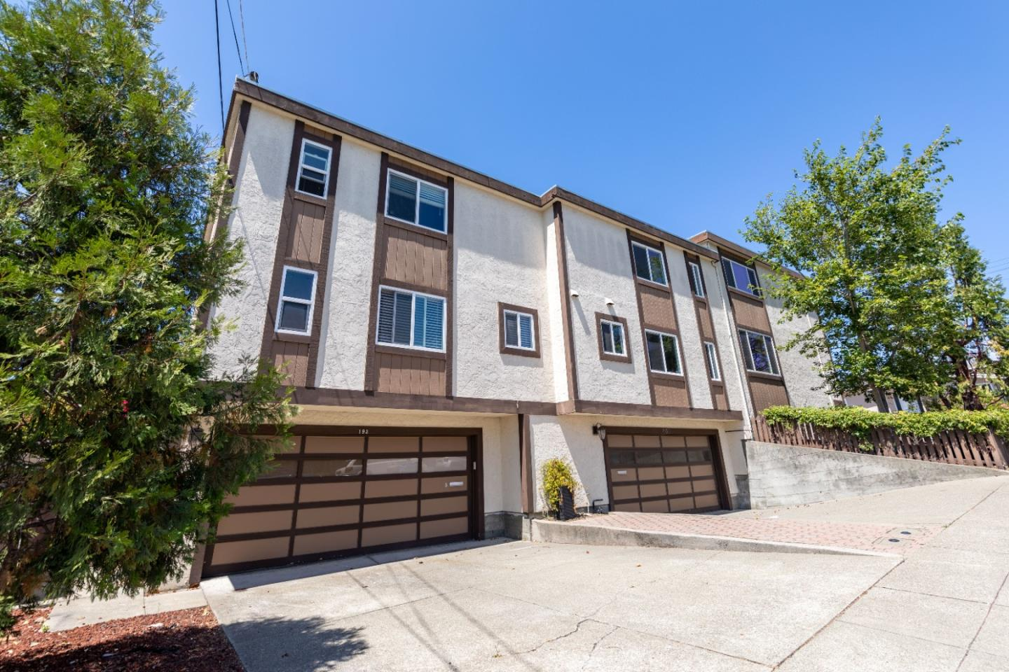 An impressive light-filled condo with a large family room complete with a fireplace and picture windows. This 2bd/2ba property is not one to miss - nearby the comforts of shopping and dining and close to I-280/101 for an easy commute to SF and Silicon Valley. On the ground floor, find a half bathroom and large, open-format living space. The updated kitchen comes equipped with stainless steel appliances and a gas range stove and flows effortlessly into the dining space, creating the perfect place for entertaining guests, friends, and family. The upper level provides privacy and quiet with large bedrooms, sizable closets, and an abundance of natural light. The bathroom features a spacious stall shower, vanity lighting, and a mirror. Fresh interior paint and attached two-car garage included.