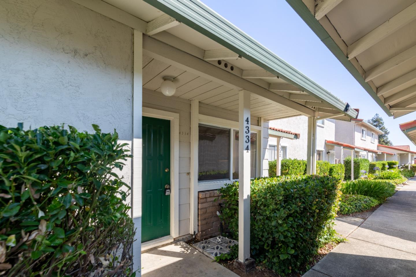 Sunny and bright - this 3bd/2ba townhome located in a highly desirable neighborhood in Concord is not one to miss! The large property features an open format layout with large windows that let in an abundance of natural light. The large living space flows effortlessly into the kitchen and the dining space, creating the perfect place to entertain family and friends or for a cozy night in. The kitchen comes equipped with plenty of cabinet space, a gas range stove, and stainless steel appliances. The owners suite is large with sizeable closets and has an attached bathroom with vanity mirror and lighting. Additional two bedrooms with large windows and a full bathroom with stand in shower. Fresh interior paint and covered one car parking included