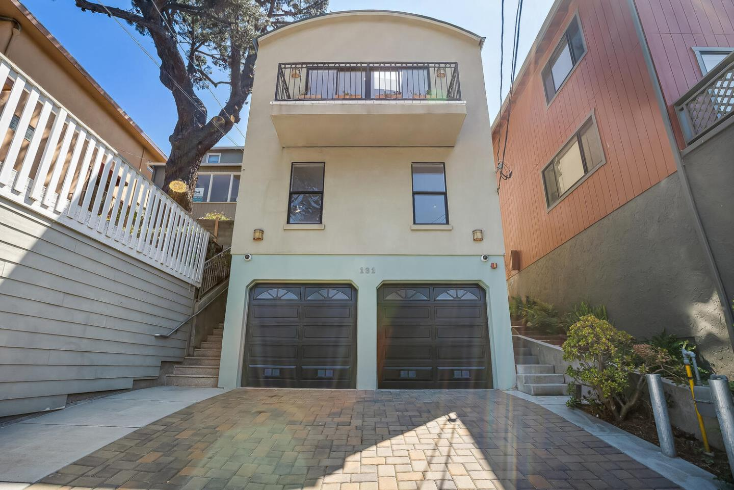 Modern Luxury Living: 3b3b single family home with views of San Bruno Mt. and built new in 2005.  Stunning main level open floor plan and great room with 15' high barrel ceilings and solid oak hardwood floors.  Gourmet Kitchen with granite counter tops, eat-in island and bar. Thermador stainless steel appliances: gas range and separate built-in double ovens. Separate dining room with sliding door to rear backyard.  This home features two balconies, a zen garden and patio,  an elevator, recessed lighting,  custom tile, fire sprinklers, 2 laundry areas, attached 2 car garage, storage rooms and an abundance of natural light. Gorgeously Oversized Master Suite with balcony, high ceilings, steam mist in shower, separate soaker tub and walk-in closet. Lower level boasts 2b , laundry room,  bathroom, and interior stairs to garage.