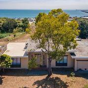 House is a Tear Down; No Value.  BUILD APPROX. 25,000 SF, 300' FROM THE OCEAN, OVERLOOK SURFFERS BEACH IN HALF MOON BAY; BUILD RESTRAINT, MULTIFAMILY, LARGE HOME OR MIXED USE!!!  CHECK OUT THE VIEW, OVERLOOKING SUFFERS BEACH, THE OCEAN, AND PILLAR MARINA! DO NOT DISTURB OCCUPANTS; Agent will provide access. Residential and Mix-Use are allowed in C-1 Zoning with a Use-Permit. Submitted plans show scale, they maxed out the buildable area of the lot. We are not guaranteeing 25,422 SF buildable area; San Mateo Co. Planning Department updated zoning regulations that may not allow same square footage. The plans submitted are attached in our listing pictures and are for 18 residential Units and 5 retail Units. This property is Zoned C-1, yet Residential and Mix-Use are allowed in C-1 zoning, with a Use-Permit.  Contact San Mateo Planning Dep. for clarity, AFTER READING COMMENTS ATTACHED.  Offers will be considered August 4th, please contact Brad Jaeb/ Listing agent for details.