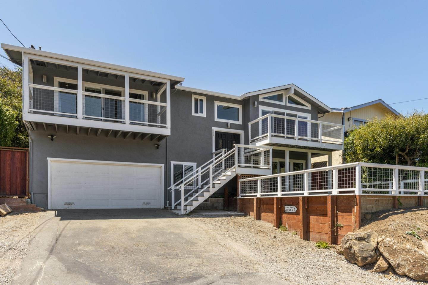 Stunning newly remodeled home with ocean views! The bright and open living space offers vaulted ceilings, recessed lighting, and beautiful flooring. The large chef's kitchen features lovely white cabinetry, a large center island perfect for entertaining, and custom finishes. The main bedroom serves as in-home retreat, with a private ocean view balcony and a luxurious en-suite bathroom. Four additional spacious bedrooms and a family room offer ample space for family or hosting guests. Spacious front and back yard areas offer the perfect space for outdoor living and entertaining. Soak in the sun setting over the ocean from the comfort of your own home! Perfectly located in a quiet neighborhood, just blocks from the stunning Pacific Ocean coastline and HWY 1 for easy commuting.