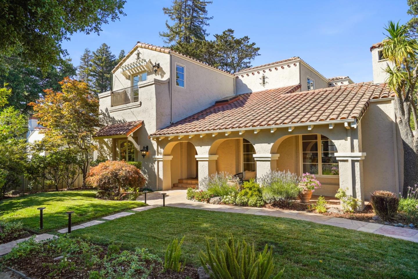 Located in the illustrious San Mateo Park District, this Mediterranean style home has charming curb appeal and stylish updates merging old-world charm into modern-day comfort for personal and social gatherings.  Spacious and practical floor plan highlights 4 BR's and 3.5 BA's (3/2 up) with multiple terraces including a master suite deck that faces the picturesque backyard, a great place to enjoy the evening light, and a Juliet balcony at the quiet street side BR overlooking the majestic Oak tree. The main level offers a light filled living room with fireplace and leaded glass window nooks.  Banquet size formal dining room has incredible period detail.  The property presents an open plan family room, Chefs kitchen, built-in office, and pantry w/underground wine cellar.  2nd master/au pair, laundry room and powder room complete the main level.  Heavenly backyard has mature trees, lawn, flagstone seating & built-in barbecue!  3,500 sf on a 12,000 sf lot.  Proximity to downtown Burlingame!