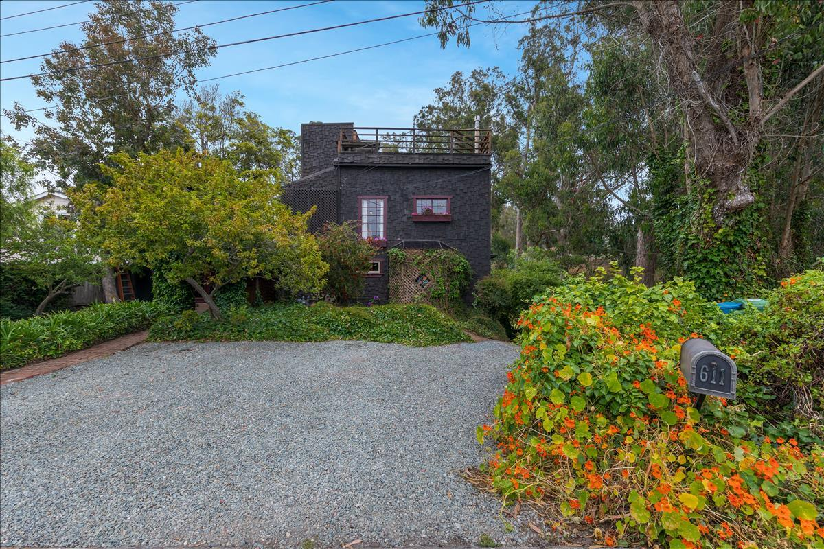 A hidden gem in downtown Half Moon Bay, this classic home on a quiet street offers creekside privacy and ultimate serenity. Just a stones throw from downtown shops and restaurants, easy access on Hwy 92 to the SF Peninsula/City. The 8700 square foot lot creates a park-like setting.Top floor master bedroom has a high ceiling and his and her closets/storage. Jetted tub has a glass ceiling above for stargazing. Sliding glass door opens onto a large redwood deck with afternoon sun. Crows nest and upper deck , perfect for gathering of friends. Main floor kitchen features custom redwood cabinets and stainless steel appliances. Living room has windows across two walls with expansive views. Work in your private office, as your desk looks out French doors onto a secluded garden with fruit trees. Lower floor has access from the interior as well as a separate exterior entrance with its own private deck. The space has a living room with wood burning stove, and a new tiled shower in the bathroom.