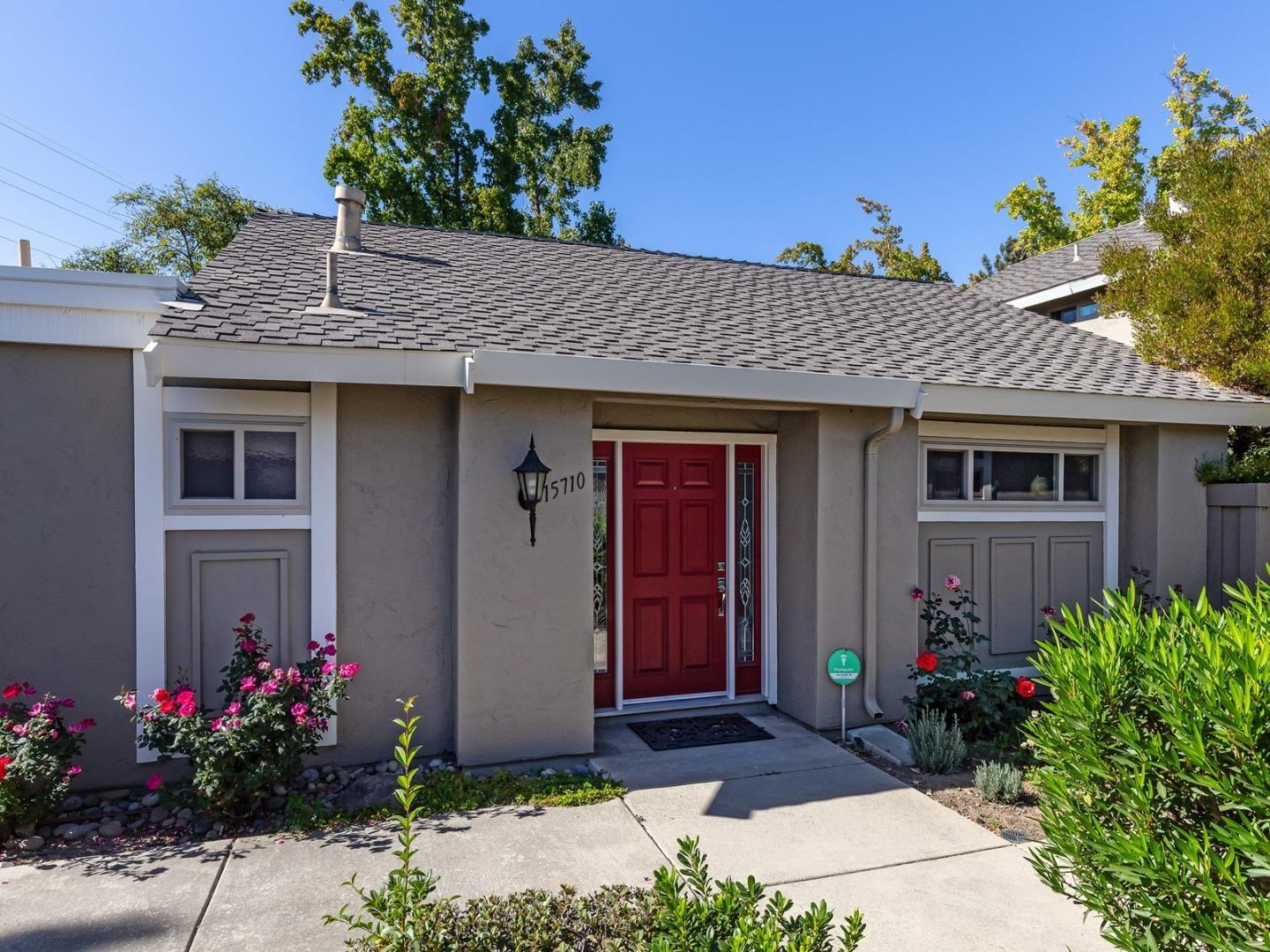 Welcome to one of the most beautiful single level townhomes in Los Gatos!  Exquisitely redone in 2015! Well-configured kitchen, newer brushed stainless appliances, Quartz countertops, Carrera marble backsplash, and large picture window. Living room with vaulted ceilings and dining area, both with warm, natural light from the expansive patio with huge double glass sliders! Two full baths appointed with Quartz countertops, beautiful Carrera marble showers, beveled glass doors. Large master suite includes built-in organizers and sliding doors to the private, landscaped patio. Modern office doubles as a guest room with built-in wall bed unit. All new doors and double paned windows with exquisite French White Oak hardwood floors throughout, Pergola and pavers enhance the oversized, private patio.    Former model home and end unit with attached 2 car garage a park-like setting community pool, and convenient location, close to everything Los Gatos has to offer.  You will love it!