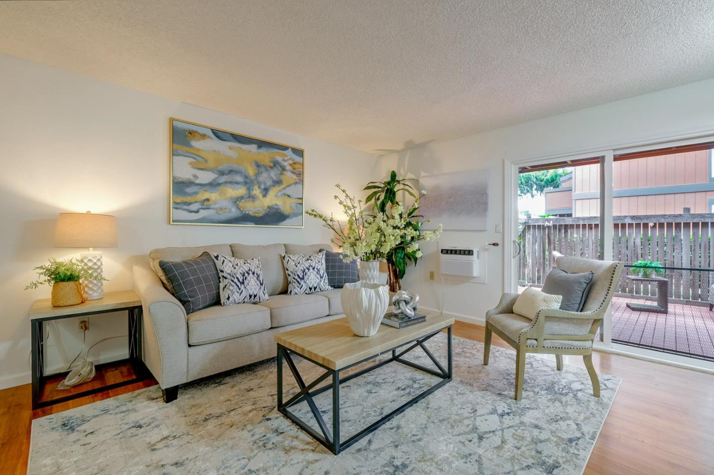 This ground floor condo unit in Central Fremont features both modern upgrades and a privately fenced patio in desirable Fremont Oaks Community. The living room is cozy and open with large sliding doors and leads off to the charming patio. The outdoor space is the perfect place to relax and entertain guests. Convenient in unit laundry, assigned covered carport and electric baseboard heating and brand new window air conditioning. Granite kitchen counter and breakfast bar, ample cabinets for storage. The outdoor space is the perfect place to relax and entertain guests. This complex boasts a Clubhouse, swimming pool, basketball court, and walkways for your strolls.  HOA includes trash and water/sewer, lawn care, insurance, pest control and exterior maintenance/repairs. Easy access to HWY 880, 238, 680, 84. Located close to BART, Lake Elizabeth, grocery stores, library, hospitals and restaurants.