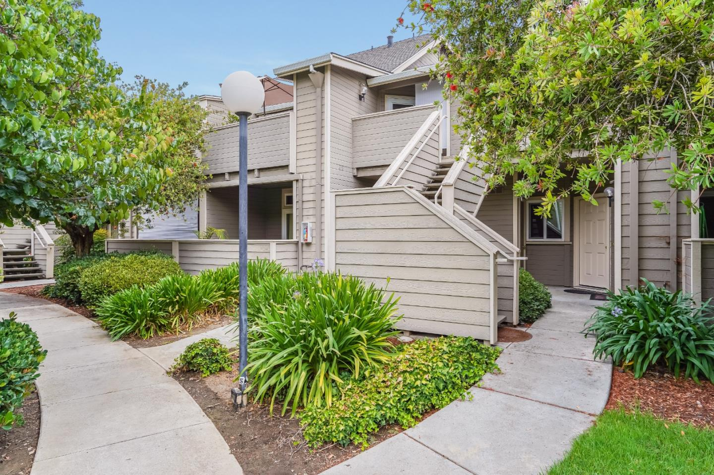 You found it!  This centrally located 2 bedroom 2 bathroom ground level condo is minutes away from Willow Glen, Caltrain Station, Downtown SJ and more.  Secured and gated community with well manicured grounds and outdoor swimming pool.  Nicely updated interior features a kitchen with stainless steel appliances, granite countertops and backsplash.  Updated vanities and tile in both bathrooms.  Newer laminate flooring and brand new carpets in both bedrooms.  Recessed lights shine bright from high cellings, creating a feeling of space and airiness.  Dual paned windows throughout, provide great insulation for the interior.  Sliding door leads to private patio to enjoy the beautiful California weather.