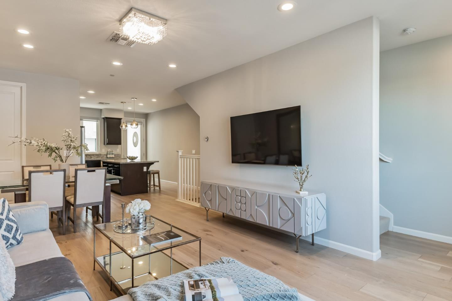 An enviable locale and a hip, convenient lifestyle are the hallmarks of life at 5506 Iron Horse Pkwy.  2018 built, 1,443 sq.ft of sophisticated and refined design in this coveted east-facing townhome style condo offers two private bedrooms, and an office / versatile space on the ground floor.  Meticulously maintained, a true move-in ready home is loaded with upgrades such as wide plank white oak flooring, brand new stair carpet, EV charger, water purifier system, and custom window shades.  Experience the best location of Dublin! Close to freeway access, shopping plaza, restaurants, and many other conveniences that are needed everyday.  Leave your car in its own attached private garage and walk to Dublin/Pleasanton Bart station.  Don't forget the community's  five-star amenities & the new 14,500 sq. ft recreation center that has fitness rooms, a game room, lounge spaces, & pools.
