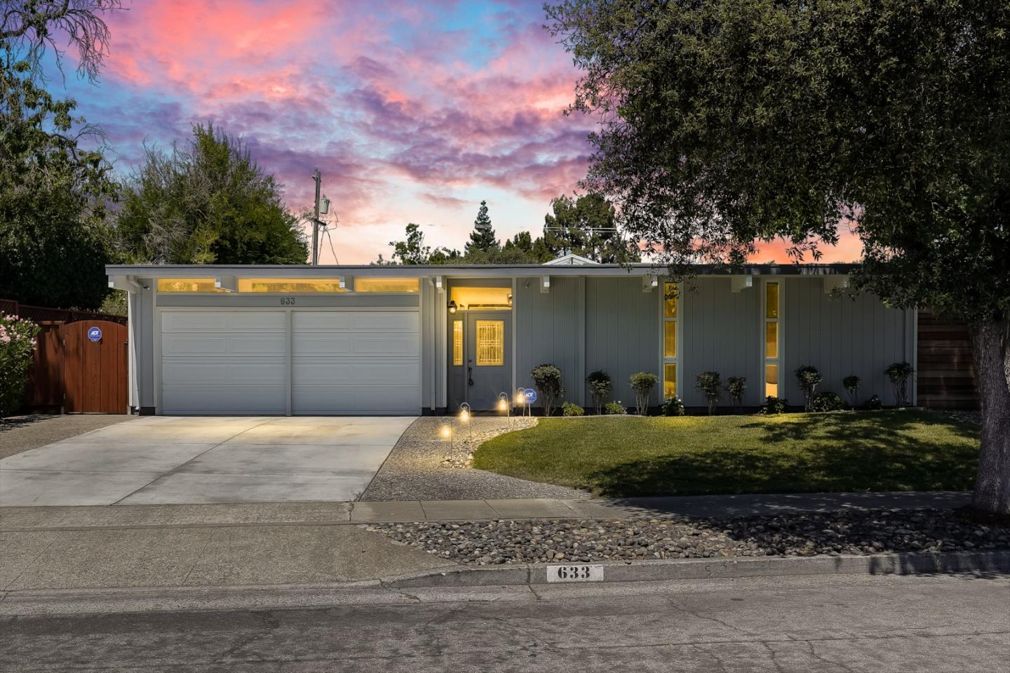 This peaceful Eichler home in Sunnyvale's Fairbrae neighborhood was completely remodeled in 2007. Leave Silicon Valley behind as you walk through the year-round open-air atrium with motorized sliding glass ceiling. Relax and entertain in a private backyard paradise with built-in swimming pool, waterfall and spa. Iconic Eichler features include: open beamed ceilings and floor to ceiling windows which bring the outdoors inside.  The sun-filled kitchen has granite countertops, island breakfast bar w/ wine fridge, gas stove, and new stainless steel appliances.  The primary bedroom also has its own bathroom, walk-in closet w/ built in shelving and access to the backyard.  The formal dining room opens into the formal living room with its gas fireplace and backyard access.  Other features: Separate laundry room, attached 2 car garage, high-tech A/C wall units and cozy radiant heated floors.  Located on a quiet street, close distance to the Fairbrae Swim & Racquet Club, Las Palmas Park.