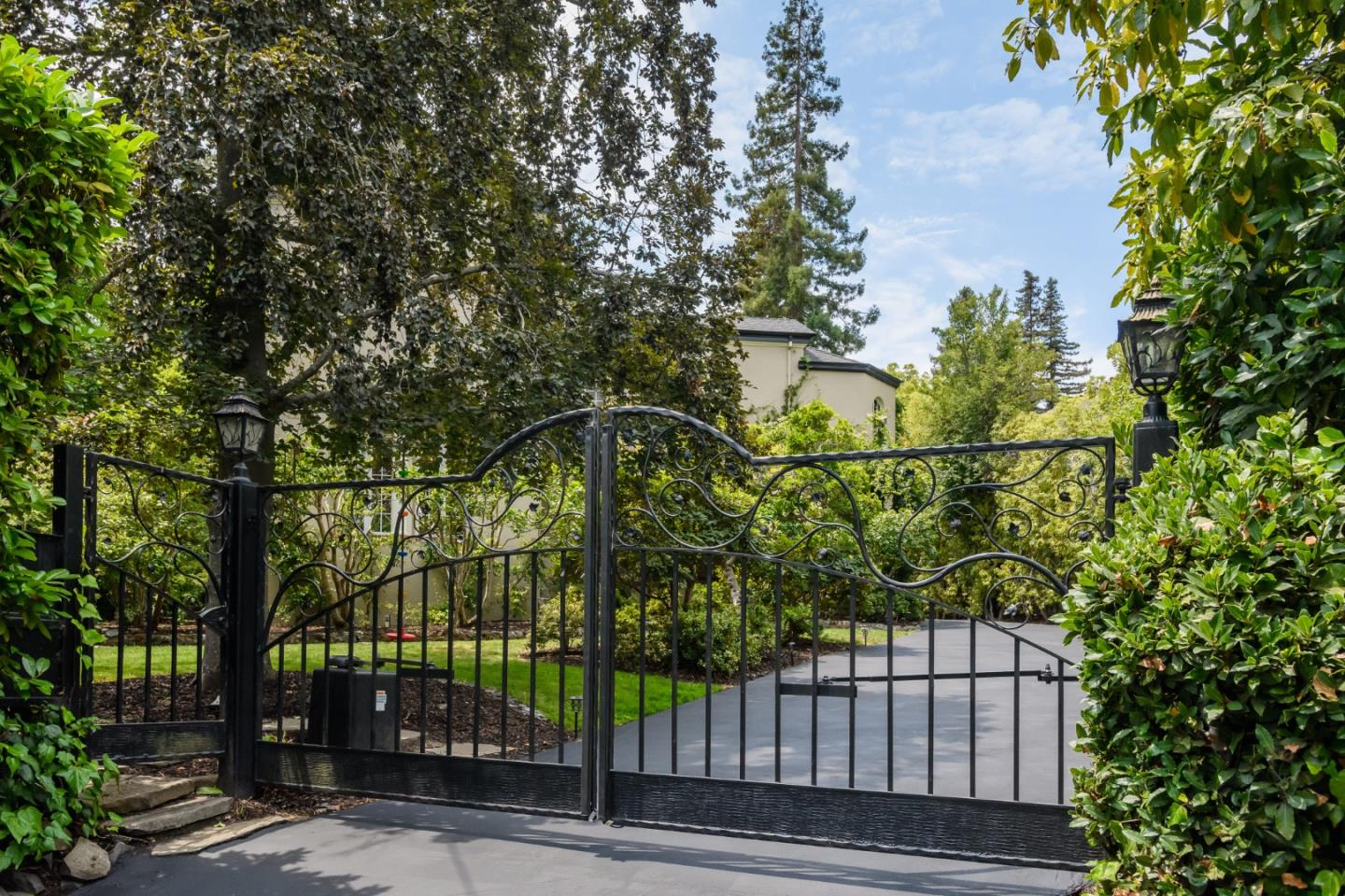 Guarded by an intricate wrought-iron gate, this beautiful residence in coveted Lower South Hillsborough arcs around to a stone terrace courtyard and vine-covered pergola, a romantic setting that steps down to a spacious grassy yard and lush landscaping. Inside, details abound - crown molding, paneling, wainscoting - while numerous windows and French doors usher in light. The foyer leads to a spacious living room with a fireplace, then into a library with courtyard access. Entertain in the sophisticated formal dining room or host in the exquisitely remodeled gourmet kitchen, with new countertops, backsplash tile & Viking appliances amid a butlers pantry and storage. Just off the kitchen lies a dedicated office, as well as a breakfast nook and a mudroom connecting to the terrace. Then, climb up the distinctive staircase to choose among 5 generously-sized bedrooms, 4 of which are en-suites - each bath tastefully renovated with marble and heated floors. (County Records shows 4BR/4.5BA)