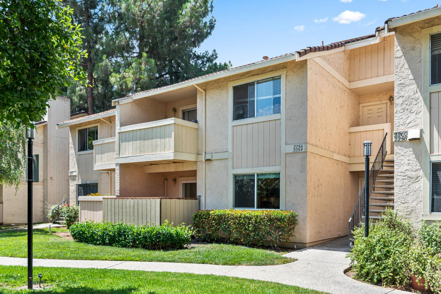 Gorgeously updated bright and airy downstairs unit, 2 Bedroom/ 2 Bathroom ready for immediate move-in! Original owner had many upgrades done. Open floor plan with private patio and patio storage. Air conditioned unit makes life cool. Many upgrades include newer remodeled kitchen, newer KitchenAid refrigerator, dishwasher, microwave. Are you a great cook? Your gas stove is ready for you! 2 updated full bathrooms, and newer installed laminated floors throughout the unit. Laundry in unit, washer and dryer included. Newer doubled paned windows, new paint, new water heater and closet organizers as well. Two assigned parking spaces (one carport covered, one open) visible from your bedrooms. Community swimming pool with facility room. Walk to the Regional Medical Center and a wide variety of local shops and restaurants. Easy access to 280, 680, 101 freeways, hospital/clinic, schools and surrounding stores and public transportation.