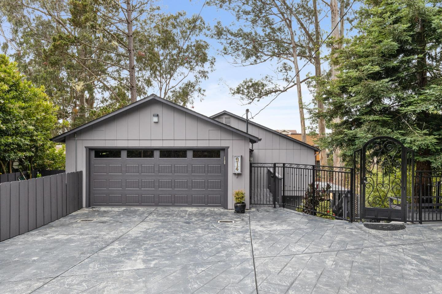 Wow! Fully remodeled in the last couple of years, this almost 3,000 sq. ft. home with a bonus unit in El Granada's sunbelt checks almost every box. Storybook entryway opens to private garden courtyard with your very own redwood tree! Generous main floor contains warm and open living areas that connect to decks and outdoor spaces. Granite counter tops, high end appliances, spacious pantry, and tons of storage on this main floor; Ascend to the upper floor where you'll find 4 full bedrooms and 2 beautiful bathrooms with toto in wall toilets, well equipped laundry room, and even a peek-a-boo ocean view! Extremely cool permitted bonus space on the lower level. At almost 650 sq. ft., this flexible space contains full bathroom, kitchenette, large, private patio, and its own driveway and entrance. Easy walk to the Princeton harbor, many local restaurants, the legendary coastal trail and miles pristine beaches.