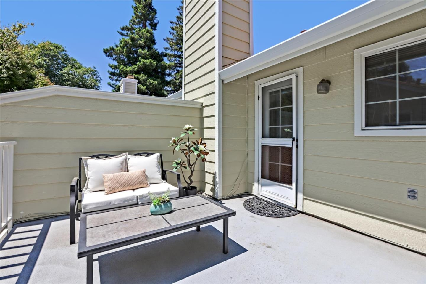 The epitome of curb appeal, this rare end unit is set in highly coveted community with just one neighbor. Luxurious yet livable, this turnkey townhome affords an open concept with custom fixtures and finishes throughout. Freshly painted and appointed with new vinyl flooring/carpet, this 3bed, 2.5bath home offers ample windows and a skylight to invite warmth and light. Decked in S/S appliances and granite counters, a modern kitchen flows into a lavish family room that contains a marble fireplace and French doors that reveal a spacious backyard patio. Upstairs is complete with mirrored closets,Jack & Jill bath, and laundry, a grand primary suite includes an ensuite bath,French doors, and a private patio. The residence is equipped with a Nest thermostat and attached 2 car garage.Set in a storybook neighborhood w/ lush dog walking paths, the HOA includes garbage & insurance. Close to Google, NASA & top tech campuses, its centrally located near light rail,Caltrain & downtown MV. This is it!