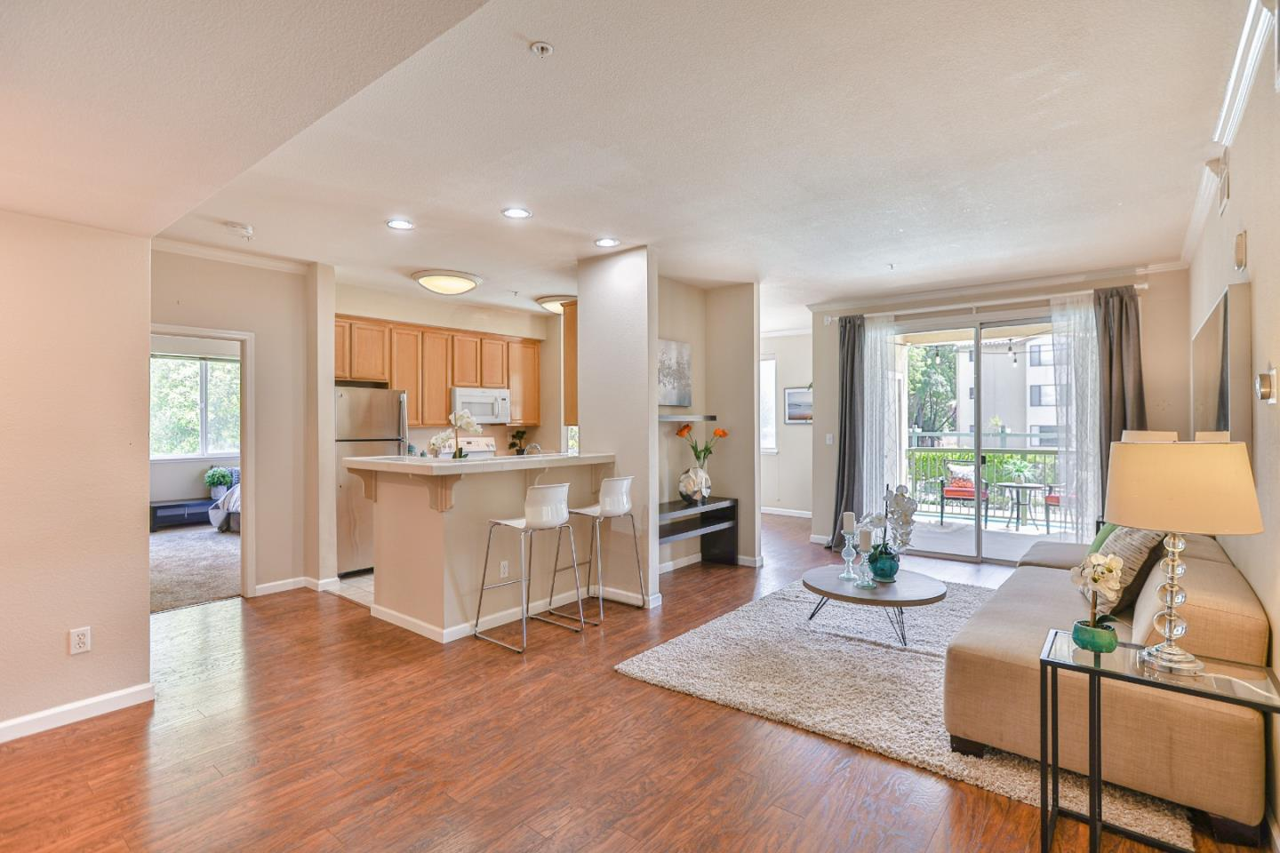Convenient and sought-after ground floor, corner unit luxury condo situated in the highly-desired Parkmont area of Fremont. Wonderfully bright & airy floorplan with sizable private balcony overlooking the sunny & sparkling swimming pool  perfect for basking in the sun. Roomy dining room with addl eating area at countertop breakfast bar. Spacious master bedroom with en-suite bath. Both bedrooms have generous-sized walk-in closets. In-unit laundry room has full sized washer/dryer. Complex secured via common entrance with elevator access & reserved, covered parking with plenty of street parking for your guests. Easy commute location! Only a 10 min walk to BART and minutes to all major Silicon Valley tech companies, main thoroughfares and public transportation. In close proximity to highly-rated schools, Whole Foods, Trader Joe's, Lake Elizabeth, Fremont Hub, Public Library, Philz/Peets/Starbucks Coffee. Enjoy a relaxed suburban atmosphere with the convenience of city living!