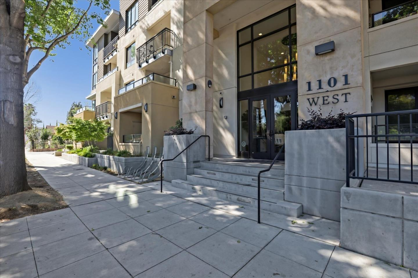 Commuter's Dream Location! Just a block from downtown Mountain View. This unit is away from El Camino Real and it's located at private quiet corner. Big windows with timeless white window shutters, abundant natural light brighten the elegant hardwood floors. Stylish kitchen features Bosch appliances, quartz countertops, European-style cabinetry, & island w/ breakfast bar. Unwind in your generous master suite showcasing soft carpet, a large walk-in closet & a tiled ensuite. Expansive and private corner patio to entertain your guests on summer days. Additionally, you'll have in-unit laundry, secured underground parking, with additional lockable storage space underground, a bike pavilion, dog run area & a lounge area w/ outdoor kitchen & fire pits. Plus, you will enjoy many shopping & dining options within walking distance & farmer's market in downtown Mountain View.  Short commute to Google, Apple, Facebook & major employers. Come call this adobe your own before someone else does!