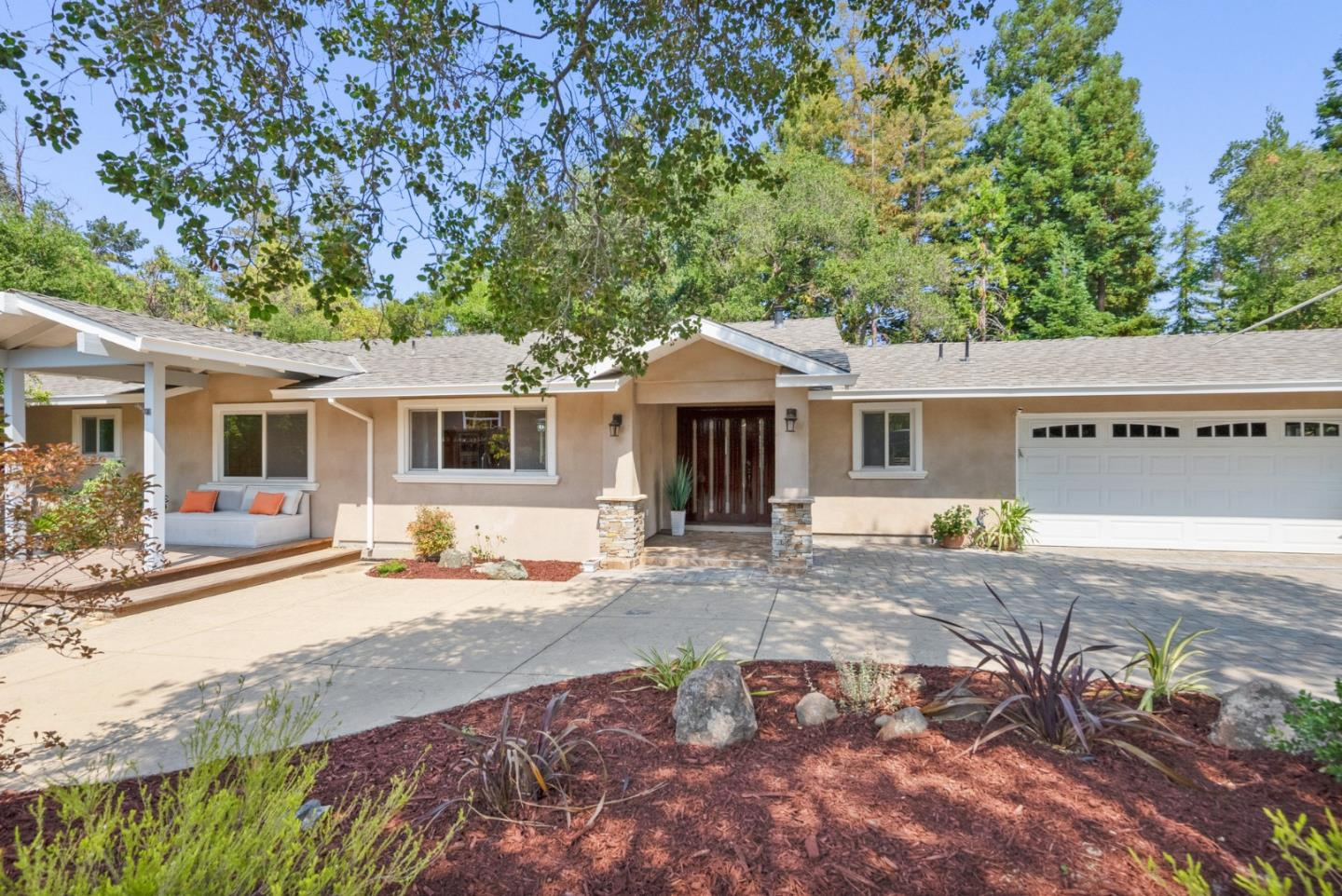 Welcome to 14527 Westcott Drive, a home located at the back of cul de sac offering a park-like setting on over ½ acre, with sunny patios & trails that meander through tiered gardens. The house was completely remolded in 2017. The kitchen featuring Quartz counters, a glass-tile backsplash, an oversized island, and SS appliances that include a 5-burner range. Connected to the open concept living area via a pass-through window that allows light to flow, a bonus room makes a great family room, office, or gym. Wood floors are found throughout, and each common area features a sliding door that connects to outside spaces. Four bedrooms feature recessed lights, and newer bathrooms have on-trend style. A junior suite offers an ensuite bath, and the primary bedroom has deck access, a custom closet, shower w/bench seat & soaking tub. The thriving community is just minutes from schools & downtown Los Gatos and downtown Saratoga.