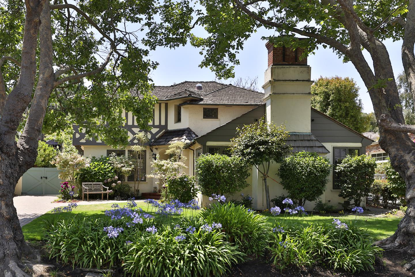 Come see, Freshly Painted Spacious Baywood 5 Bedroom and 3 bathrooms English Tudor updated to maintain original 1936 character. Beautiful hardwood floors throughout with gorgeous mahogany woodwork. Updated kitchen with new appliances. Fifth Bedroom used as family room. High efficiency furnace. Dual pane windows. French doors lead from dining room and breakfast room to beautiful patio and serene garden.  CedarWorks Playground right in your backyard.  Newly renovated studio, designed as game or artist play room.