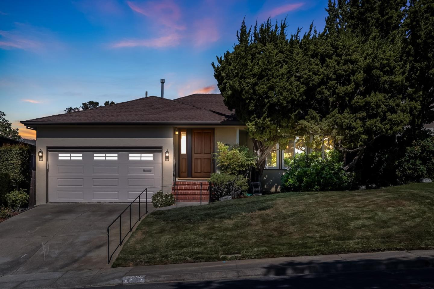 This California Ranch style home is prominently situated on Nevada Avenue with mature trees and the perfect balance of front and backyard space. The home floor plan makes for easy living with a spacious living room and dining room grouped around the centrally located kitchen. The central hallway connects the more formal front with back area featuring the three bedrooms and two bathrooms, opening up to the semi-enclosed back patio. The back yard in parts evokes Karesansui , the crown jewel of which is the Japanese tea house - an authentic period piece of the 1950s, which shares the heritage and traditions of the tea houses in San Mateo's Central Park and Golden Gate Park's Japanese Garden of the same period. As a successful blend of Eastern and Western design and style principals, this home features the best of Mid-Century California in the Baywood neighborhood - one of San Mateos most prestigious areas to call home!