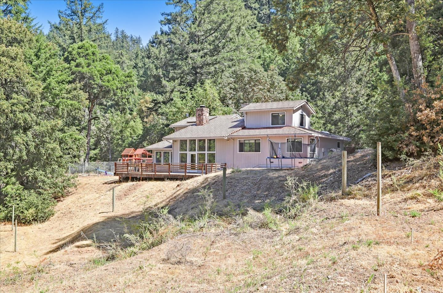 Welcome home to 12340 Footpath Trail in Los Gatos! Enjoy peace & quiet among the redwoods on 13.4 acres in this 5 bed & 3 bath home in the gated Indian Rock Ranch Community. Top Los Gatos-Saratoga High School District (buyer to verify). Remodeled in 2017 with NEW water heater, electrical panel, furnace, air conditioning, LED lighting, pressure pump, whole-house water filtration system, ceiling fans. Brazilian Cherry hardwood floors with inviting formal living & dining rooms with vaulted ceilings & easy access to the expansive deck. Kitchen features quartz countertops, subway tile backsplash, & island with gas stove. Hall bathroom features radiant heated floor. Bring your imagination with large secondary flat area for possible ADU or guest house (buyer to verify). San Lorenzo river with waterfall & natural springs on property. Nearby parks: Castle Rock, Big Basin, & Saratoga Gap. 8.5 miles to Downtown Saratoga with easy access to Silicon Valley via Skyline, Hwy 9 & 17. Dont miss out!