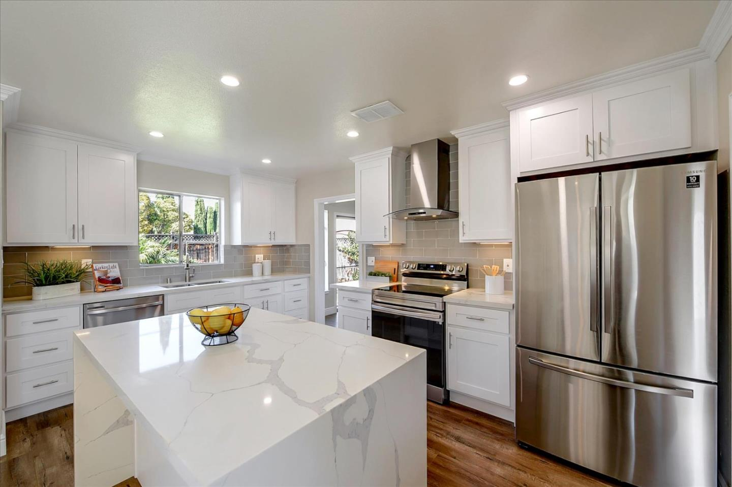 Wow! This is it! This elegantly remodeled Willow Glen home, has much to offer! This 3 bed 2 bath home with nearly 1700 sf features a spacious, remodeled kitchen with brand new kitchen cabinets, new stainless steel appliances, new quartz, with a waterfall finish, and a subway tile backsplash.  It also has a brand new 30 year composition roof! The home also has new laminate floors throughout, with fresh paint on the interior and exterior. It has remodeled bathrooms with lighted mirrors, and new vanity cabinets. The home has new crown moulding, new baseboards, new recessed lighting, & new tile on the fireplace. There's too much to list! Due to a delay in delivery, the new double pane windows and double pane doors will be replaced as soon as those arrive. All windows, and glass sliding glass doors to be replaced with brand new ones. 888 Redbird Dr. just closed for $1,480,000. That home was smaller and had original materials on the fireplace, and the bathrooms weren't recently remodeled.