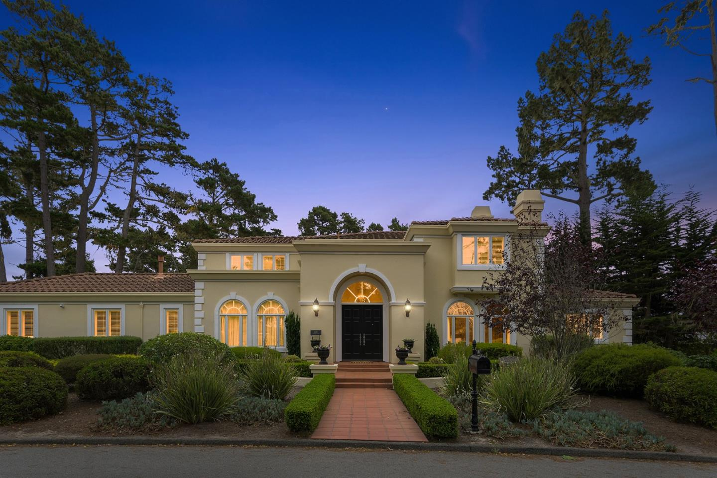 Elegance delivered!  The sophisticated home stands proudly on a level, manicured lot in a prime location near both Spyglass Golf Course and Pebble Beach Golf links, and less than 1 mile to the shores of the Pacific Ocean.  Offering a play of spaces, the stunning living room is grand, filled with light, ideal room to gather with friends, yet offering more private rooms like the formal dining room, an office, and the warm den to watch TV and cozy up while the fireplace runs.  Offering a main floor suite, allowing you to live all on one floor.  On the second floor larger, a principal suite and a generous sized guest room with ensuite bathroom.  Step outside to the sheltered courtyard that wraps around the entire backyard.  Al fresco dining all season long on this patio, take in the rose garden that fills the space, at the end of the day, simply pull your chairs up fireside and relax. The well maintained home provides the perfect setup for a second home or make it your full time residence.