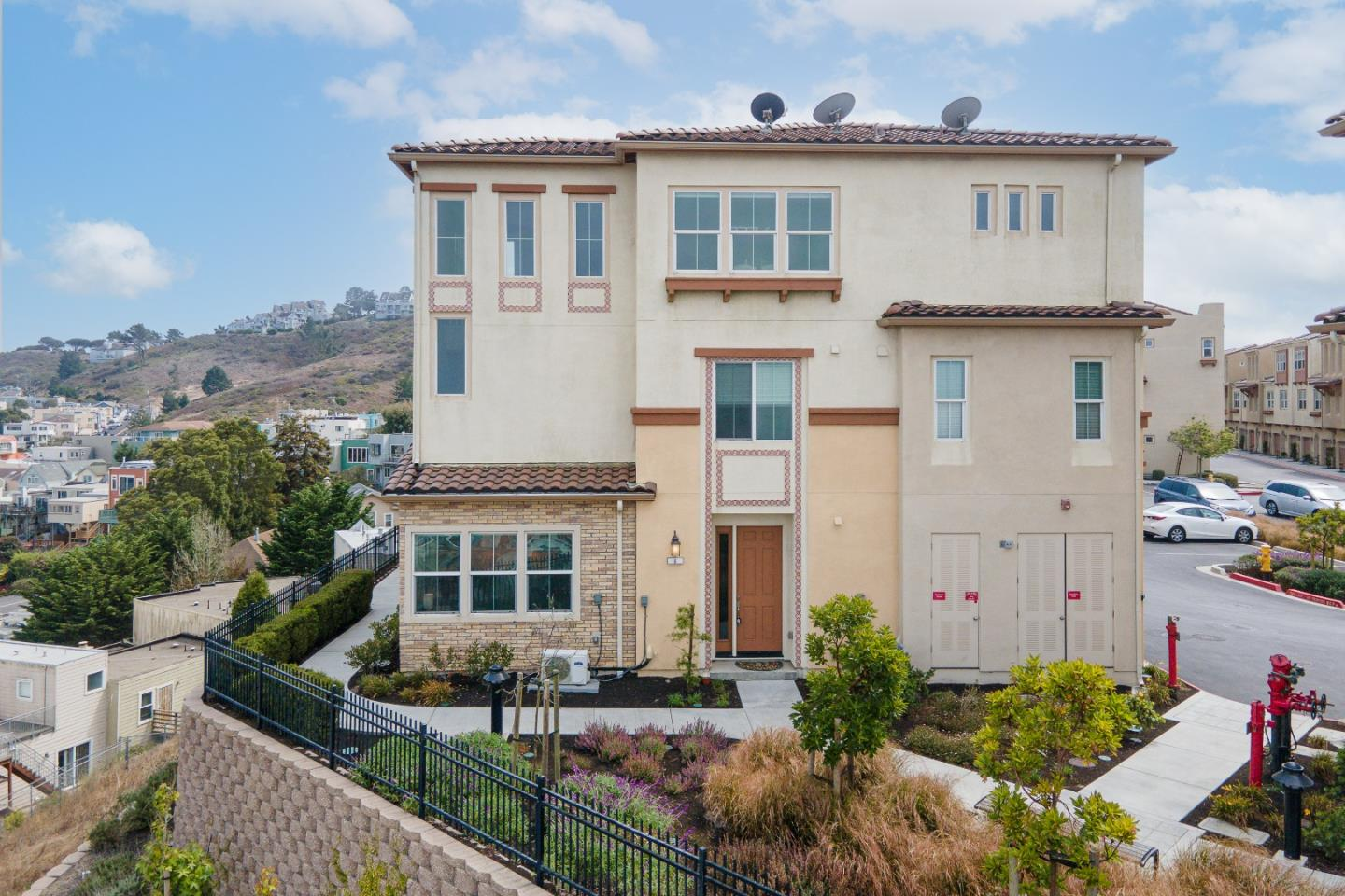 """THIS IS A MUST SEE!! Modern & Move-in-ready, 2beds/2.5baths + 1 open bonus room on 1st floor, home built in 2017, in sought-after gated community at the top of the hills, standing at the balcony enjoying """"Million Dollar Views"""" of San Francisco bay and Daly City. On upper level, entering into an open living rm with abundant natural lights, dining area & chefs kitchen with abundance of cabinets stainless steel appliances, quartz stone countertops and seating bar. The generous sized master-room including walk in closet and dual sinks & shower tub, stall bath. Features, dual pane windows, AC/Central Heat, in unit laundry, modern guest bath & attached two car garage w/ storage, pre-wired for EV charging, tankless water heater. Amazingly convenient location in quiet retreat-like secure neighborhood with amazing views, near shopping, restaurants, BART, and minutes to HWY101/280, San Francisco downtown. Any question, text/call 510-630-8121. OPEN House: 9/17-9/19."""