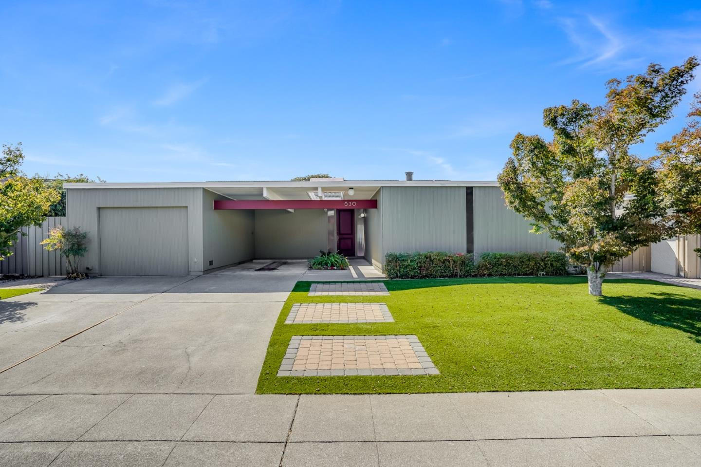 Welcome Home! This beautiful Eichler welcomes you with stunning, vaulted ceilings and an abundance of natural light. The spacious entry provides endless options, from formal dining to a home office. This beautiful 3 bed 2 bath home features a primary suite with an en suite bath and walk in closet. Enjoy the view of the serene, wrap-around backyard from the sliding glass doors throughout the home. Ideally located near Foster citys top rated schools, beautiful parks, lagoons, nearby shopping, the PJCC, and Quick access to 92 and 101. You dont want to miss this beautiful home!