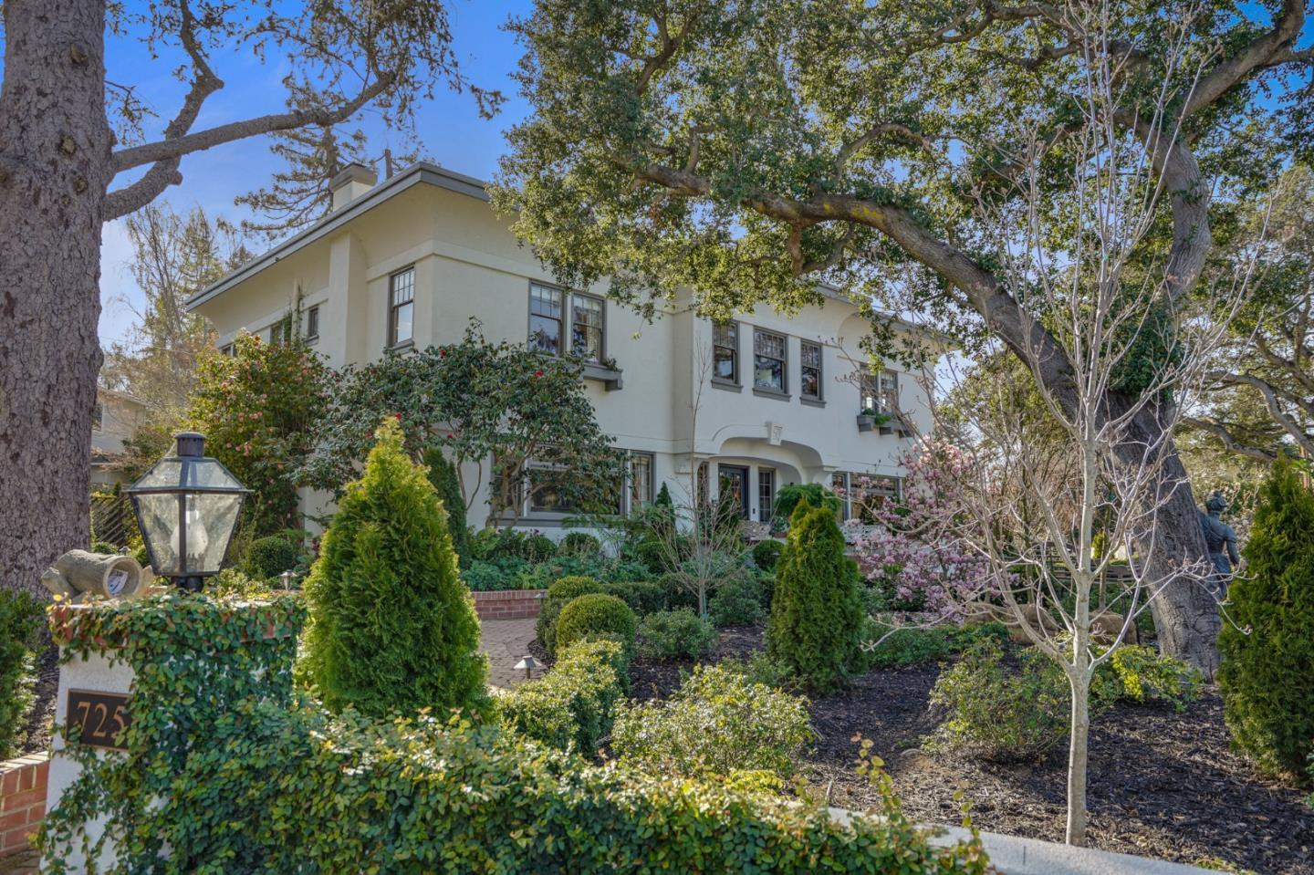 Along tree-lined streets of the San Mateo Park neighborhood, this 1913 architectural masterpiece rests on a large beautifully landscaped lot with winding walkways, exquisite gardens & picturesque courtyard. From intricate millwork to antique lighting, the remarkable residence effortlessly blends classical & craftsman design. In the main house, there is a formal entry with staircase up to 5 bedrooms + office with wide hallways, formal living & dining rooms, a well-appointed kitchen & a sunny family room with French doors leading out to the backyard retreat containing a resort style pool/spa complete with a Baja shelf. For added luxury, a recently added ADU with striking limestone floors serves as a guest house complete with kitchenette & full bath. The attached, 3-car garage is accessible through the cobblestone driveway. The character that defines this home is truly unparalleled. Quality materials, oversized rooms & location blocks from Burlingame Ave make this home a coveted treasure.