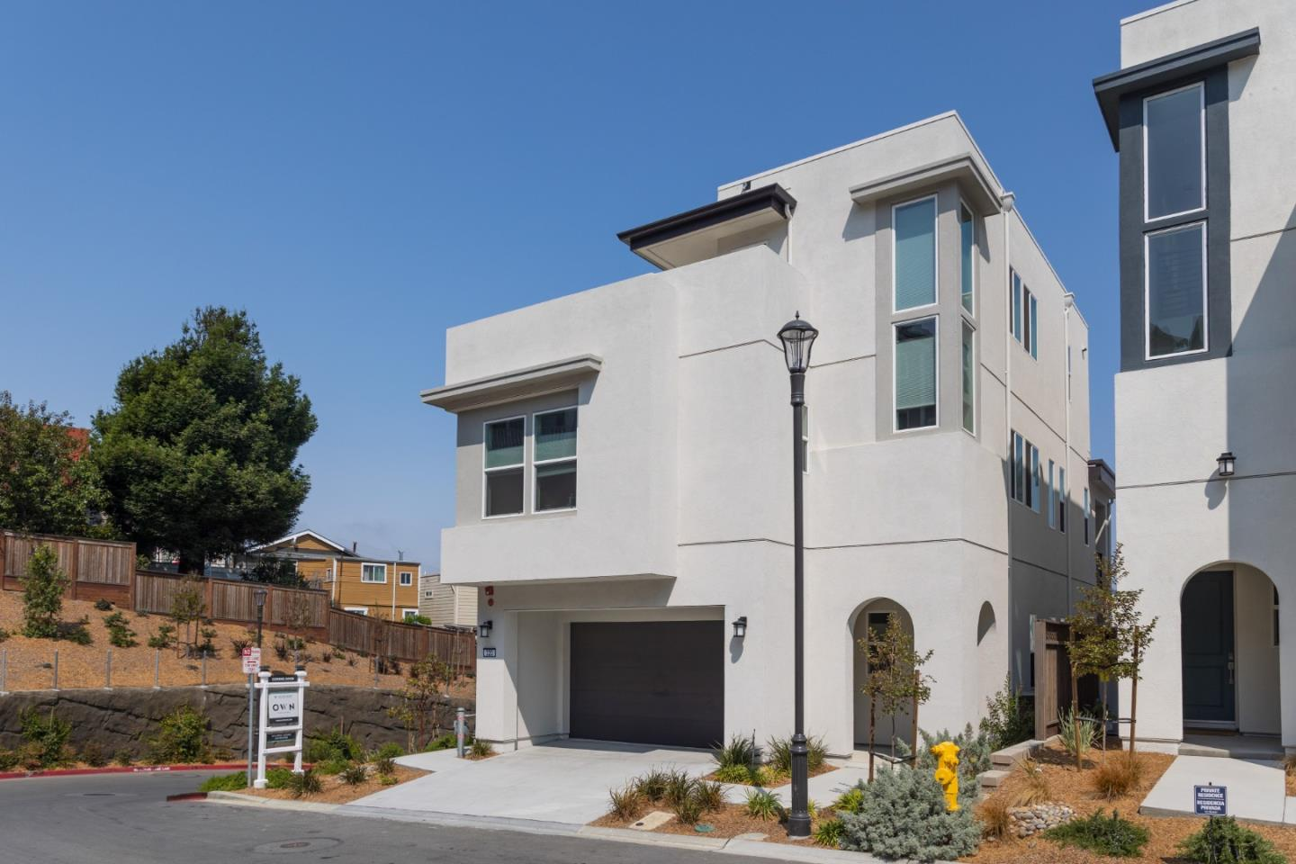 Stunning new build in a beautiful & sunny neighborhood in Daly City, the spacious, corner lot, 4-level, 4bd/4.5ba home is not one to miss! The spacious property feat. $150k in upgrades from custom staircases, blinds/curtains, light fixtures, countertops & multi-slide patio doors. On the ground floor, find a large living space & walk-out balcony w/ an open format layout that flows into the kitchen & dining space - sound system wiring ready for you! The kitchen is complete w/ upgraded countertops & stainless steel appliances. Lower level feat. an additional living room, guest bedroom, & full bath w/ separate entrance & option to add kitchenette. Upper level incl. owners suite & two sizeable guest rooms. The owners bedroom is complete private balcony & w/ en suite bathroom featuring separate shower & tub, walk-in closet, & double sink vanities. Bonus studio perfect for at home gym. Top level features loft that leads onto rooftop terrace w/ beautiful views of SF. Attached 2-car garage.