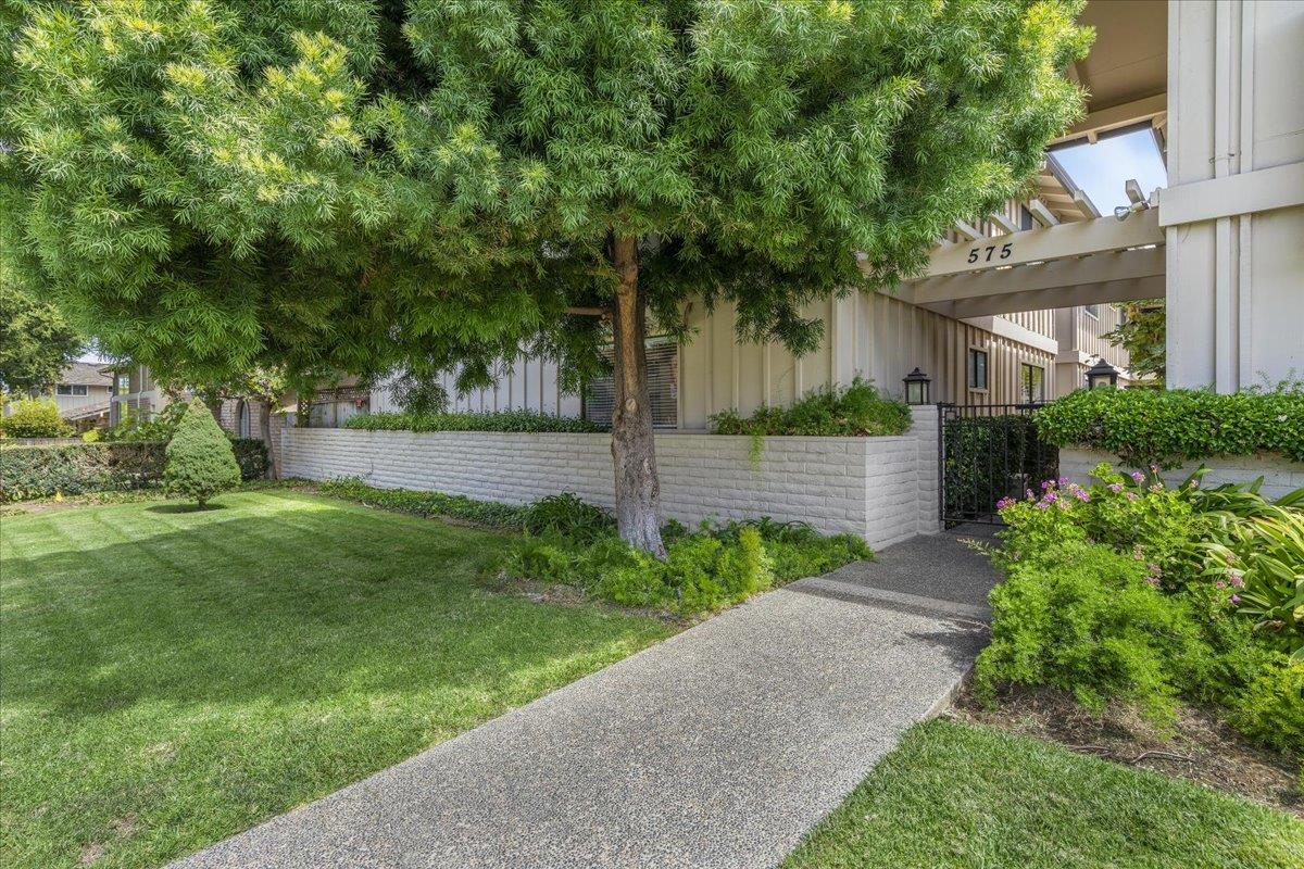 A great start in Silicon Valley! Welcome to this well maintained condo just a short stroll to vibrant downtown Los Altos with shopping, dining, & the new State Street Market! Award-winning Los Altos Schools! One level, ground floor, corner end unit. No stairs to climb! Small 9 unit complex with a sparkling pool. Low HOA dues of $400 monthly. Fresh decorator paint & new berber style carpet throughout. 2 spacious bedrooms with large closets & wood blinds plus 2 bathrooms. Large living room with gas fireplace, formal dining area & wet bar. Updated kitchen features: stainless appliances, tile counters, & informal eating area with stunning Edison bulb chandelier. Living room & kitchen both have direct access to large private landscaped patio, perfect for entertaining. Indoor laundry closet with washer & dryer included in sale. Detached one car garage with storage cabinets. Close proximity to Stanford University and major Silicon Valley companies.