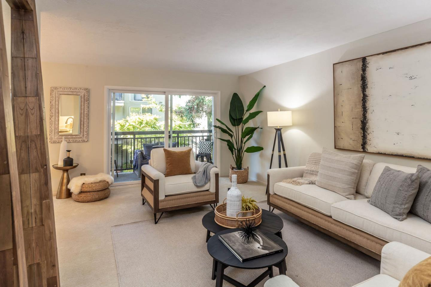 Located on the 2nd floor of a quiet, secure complex, this updated condo features spacious rooms, a large balcony, and floor-to-ceiling windows framing views of the lush, park-like interior courtyard and pool. The living room offers ample space to host gatherings, and opens to a large balcony. The dining room sits beneath a drum chandelier and features a wall of windows. The updated kitchen presents crisp Shaker-style cabinetry, new stainless steel appliances, and quartz countertops. The first bedroom has a well-sized closet with mirrored doors and a floor-to-ceiling window with courtyard views. The primary bedroom is privately located with no neighbors directly next door, and has a floor-to-ceiling window with gorgeous views of a Japanese maple. The designer bathroom features porcelain tile floors, a quartz-topped vanity, and a deep soaking tub and shower. A home in the lovely Stanford Gate community with access to Los Altos schools and close to The Village at San Antonio Center.