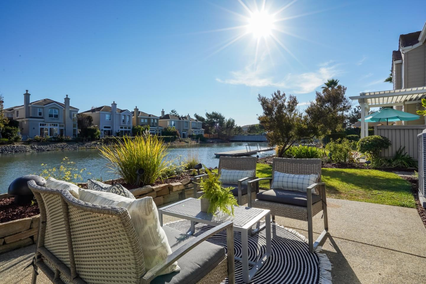 This gorgeous waterfront home offers resort style living in the Harbor Court neighborhood of RWS. Boasting extraordinary living & optimal entertaining flow. This home sits at the end of a cul-de-sac w/the backyard facing the water. This fabulous home has 4 luxurious bdrms, 2.5 baths + air conditioning.The entertainment-sized living rm w/fireplace features built in media system & gas fireplace. Formal entry boasting soaring ceilings, oversized dining rm w/a wine cellar adjoining the chef's kitchen featuring slate floors, Thermadore microwave, warming drawer, stone countertops, tiled backsplash, stainless steel refrigerator, island w/2nd oven & eat-in kitchen. The glass door opens to the patio w/mesmerizing tranquil water views & landscaped yard. Abundant natural light! Upstairs are 4 bdrms + 2 baths. The luxurious owners suite features hrdw floors, hi ceilings, 2 closets w/ waterfront views. The owners bath has a stall shower, jetted tub & double sinks. 3-car garage with a media area.