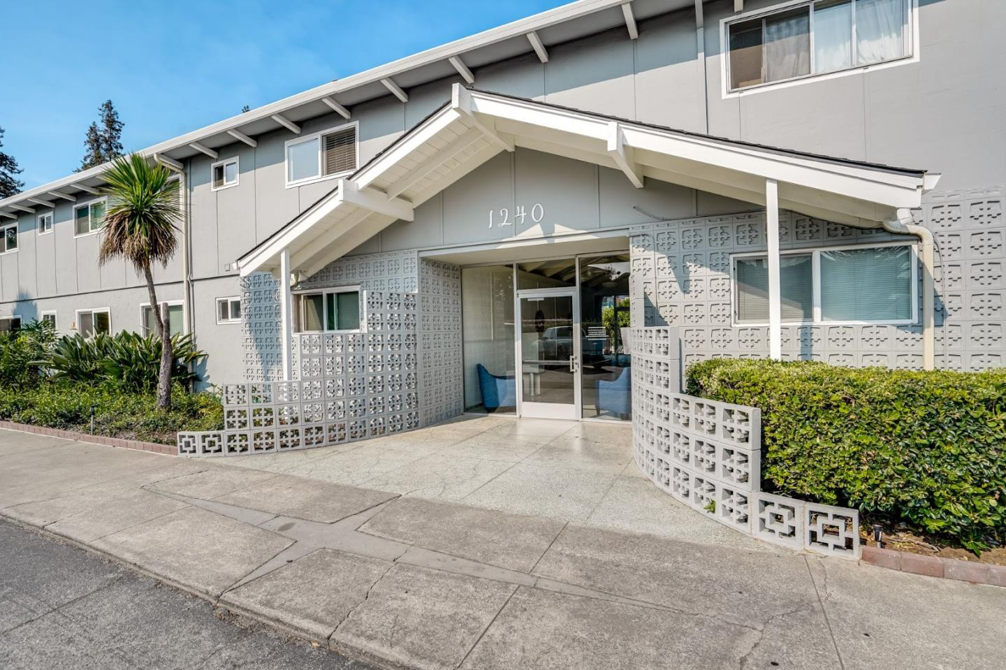 What a find! Excellent price point in prime Redwood City location! This move-in-ready, top floor light filled 2 bedroom 2 bath beauty is in the best location of the complex w/ no one below & tree views out of both bedrooms. Features include: beautifully remodeled kitchen w/ white soft close cabinetry, quartz countertops & all GE stainless steel appliances, spacious living room w/ fireplace opens to recently replaced entertainment deck for indoor/outdoor living & large master suite w/ walk-in closet. Other amenities include: tiled entry, laminate flooring, Pella dual paned windows, crown moulding, fresh paint & covered carport w/ 3 LG storage closets. Friendly complex is meticulously landscaped with pavered patios/pathways, lush vegetation, sparkling pool, sauna & club room too! Conveniently located close to Woodside Plaza, restaurants, shopping & Starbucks plus EZ commute w/ Caltrain. Low HOA dues include water, garbage, sewer & basic cable. Why rent when you can own a home like this?!