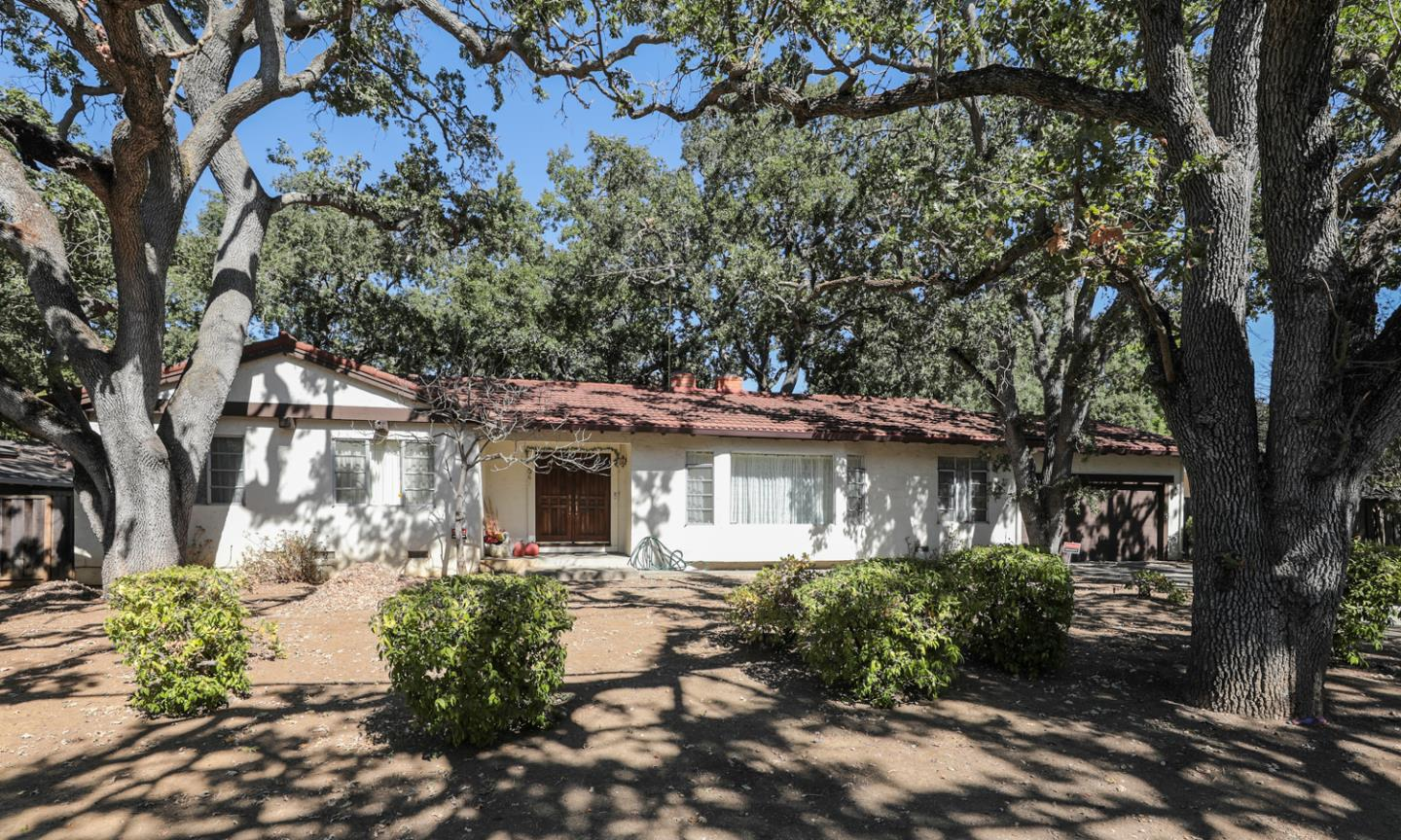 Opportunity knocks! Remodel or build new on this oversized lot. So many possibilities on this 14,286 square foot lot. Remodel/Add on to the existing 1,702 square foot, 4 bedroom, 2 1/2 Bath home built in 1972, or build a new 4,170 square foot home above ground or larger with a basement (Buyer to investigate development potential and size of new home with the City of Los Altos planning department). Enjoy an expansive backyard with a lot that is over 156 feet deep on the right side and 173 feet deep on the left side. The street frontage of the property is 103 feet (all measurements taken from the Plot Map, Buyer to verify). Situated in a fantastic neighborhood with many high end, newly constructed homes. Property is ideally located within walking distance to Rancho Shopping Center, Loyola Elementary School, Pinewood Schools Elementary campuses, and is a short distance to downtown Los Altos.