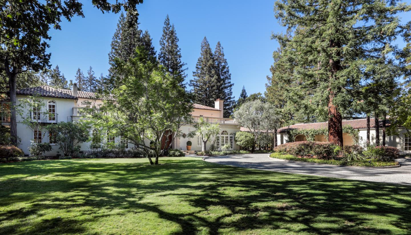 With roots dating back to 1927, this magnificent estate has been masterfully renovated over the years with complete respect for the home's early heritage. The 2-story floor plan is designed for indoor/outdoor living with ample outdoor entertaining areas including a ~515 sf loggia with fireplace plus a vast upstairs terrace of ~1,095 sf. Property grounds include a pool that blends into the formal gardens, a large tucked away sport court, a ~190 sf pool house with sauna plus ~550 SF 1-bedroom guest house with full kitchen. Palladian windows and glass doors exemplify the timeless style along with floors in hardwood and terra cotta tile. Recessed lighting, distributed sound inside and out, and total connectivity are just a sampling of the upgrades made to enhance today's lifestyle. With its modern comforts, fresh updates, and treasured heritage, this premier property is located on one of Atherton's best streets close to top-rated schools, Stanford University and downtown Menlo Park.